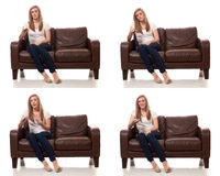 Young Woman Watching Television. Studio shot over white Stock Photography