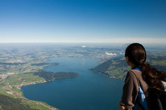 Young woman watching to the Zugersee from the top of the Rigi Royalty Free Stock Photo