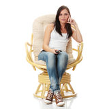 Young woman watching TV Stock Image