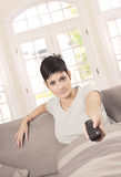 Young woman watching TV Stock Photos