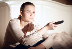 Young woman is watching tv. Royalty Free Stock Photo
