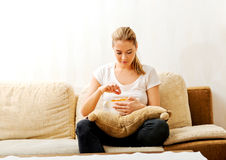 Young woman watching TV and eating chips Royalty Free Stock Photos