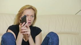 Young woman watching TV at home. bored girl with remote control stock footage