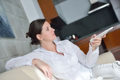 Young woman watching tv at home Stock Image