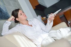 Young woman watching tv at home Royalty Free Stock Image