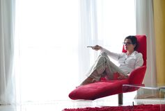Young woman watching tv at home Royalty Free Stock Photo