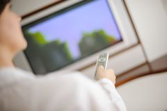Young woman watching tv at home Stock Photo