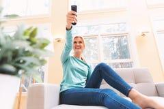 Young woman watching TV Stock Photos