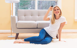 Young woman watching TV. In the living room Royalty Free Stock Photo