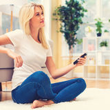 Young woman watching TV. In the living room Stock Photos