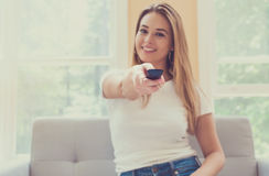 Young woman watching TV. In the living room Stock Image
