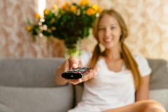 Young woman watching TV in the living room. Royalty Free Stock Images