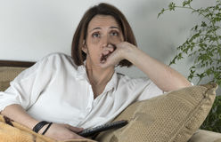Young woman watching TV Royalty Free Stock Image