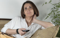 Young woman watching TV Stock Images