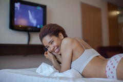 Young woman watching TV in the room. Stock Photography