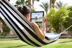 Young woman watching video on digital tablet Royalty Free Stock Image