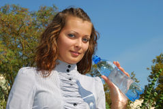 Young woman with water Royalty Free Stock Photography