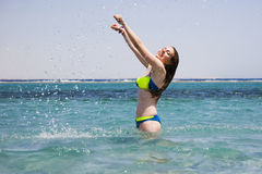 Young woman in the water Stock Image