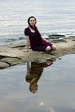 Young woman by water Stock Photography