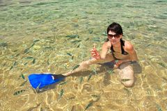 Young Woman in a water with fish Royalty Free Stock Photos