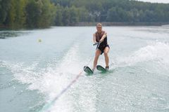 Young woman water skiing on lake Stock Photography