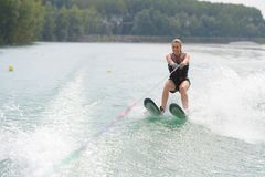 Young woman water skiing on lake Royalty Free Stock Image