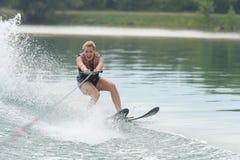 Young woman water skiing on sea Stock Photo