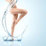Young woman with water splash Stock Photo