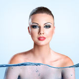Young woman with water splash Stock Image