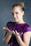 Young woman in water splashes and droplets Royalty Free Stock Image
