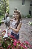Young woman with watering can Royalty Free Stock Photography