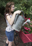 Young woman with watering can Stock Images