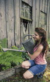 Young woman with watering can Royalty Free Stock Photo