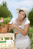 Young woman watering flowers Royalty Free Stock Images