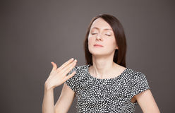 Young woman wave her palm and needing fresh air Stock Photo
