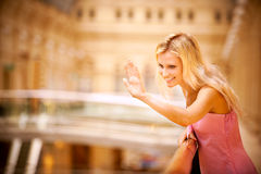 Young woman waves hand Stock Photography