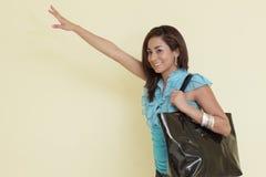 Young woman waving Royalty Free Stock Photo