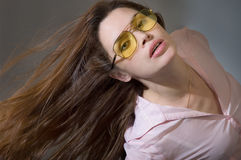 Young woman with waving hair. Young brunete woman with waving hair royalty free stock image