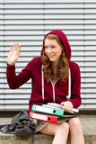 Young woman waving to her friends Stock Photos