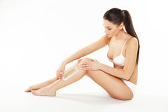 Young woman waxing legs Royalty Free Stock Images