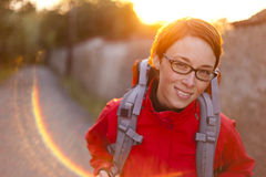 Young woman on the way with backpack  looking to camera Stock Image