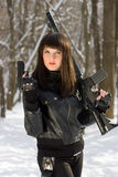 Young woman with weapon Royalty Free Stock Photography