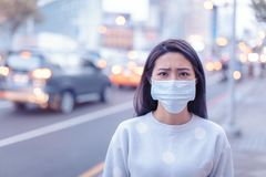 Free Young  Woman Wear Mask In The City During Smog Day Royalty Free Stock Photo - 165343435