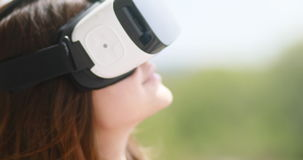 Young woman wear virtual reality digital glasses device, happy smiling beautiful girl vr technology entertainment video stock video footage
