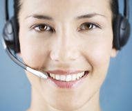 A young woman wearing an audio headset Stock Photography