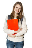 Young woman wearing a backpack and holding botebooks Royalty Free Stock Photo