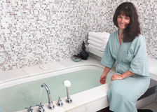 Young woman wearing  bathrobe in bathroom. Royalty Free Stock Photography