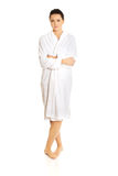 Young woman wearing bathrobe Royalty Free Stock Photo