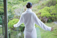 Young woman wearing a bathrobe Stock Image