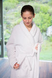 Young woman wearing a bathrobe Royalty Free Stock Photography